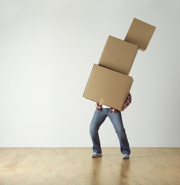 person carrying 3 stacked boxes